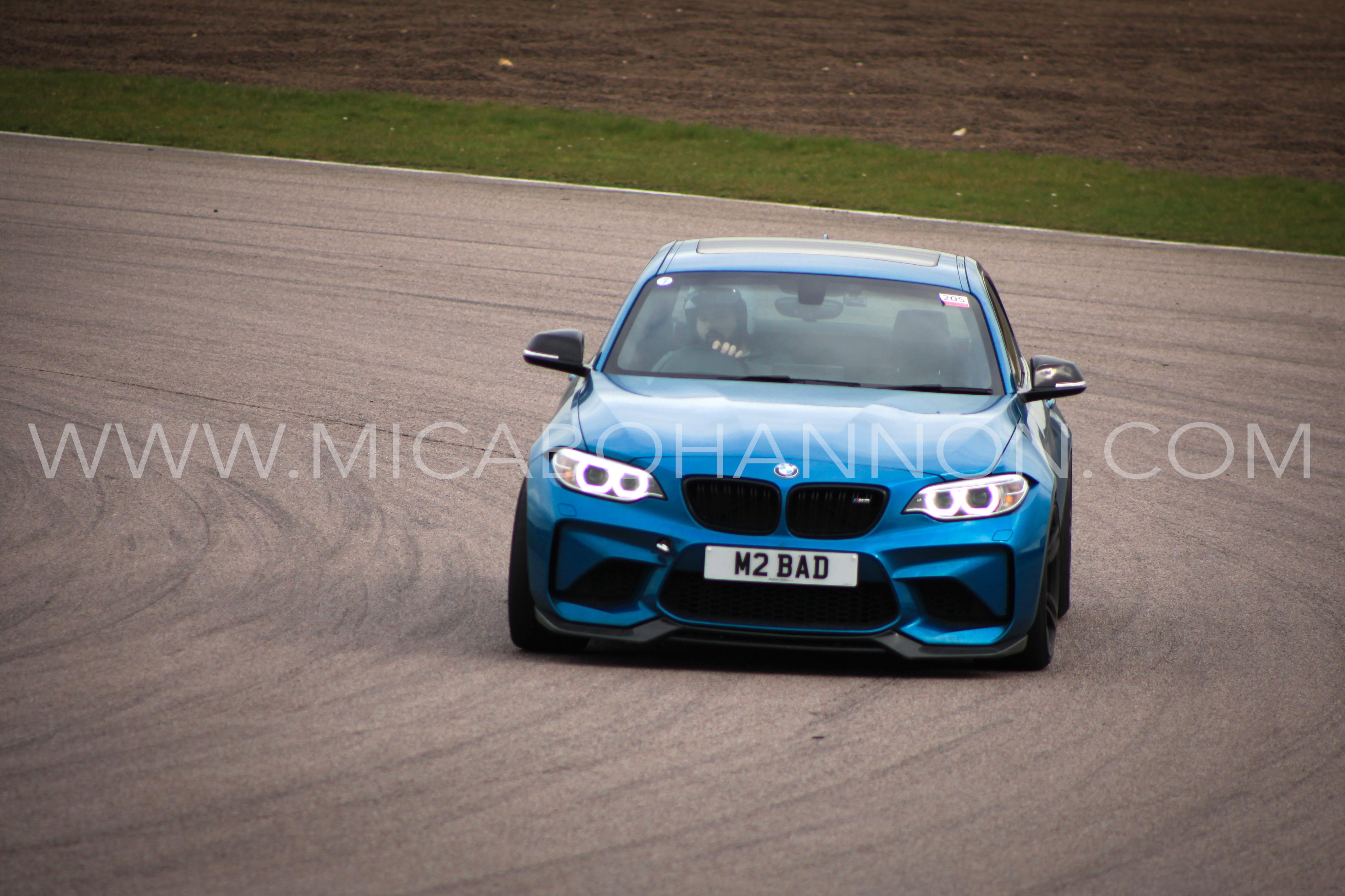 blue bmw racing round corner