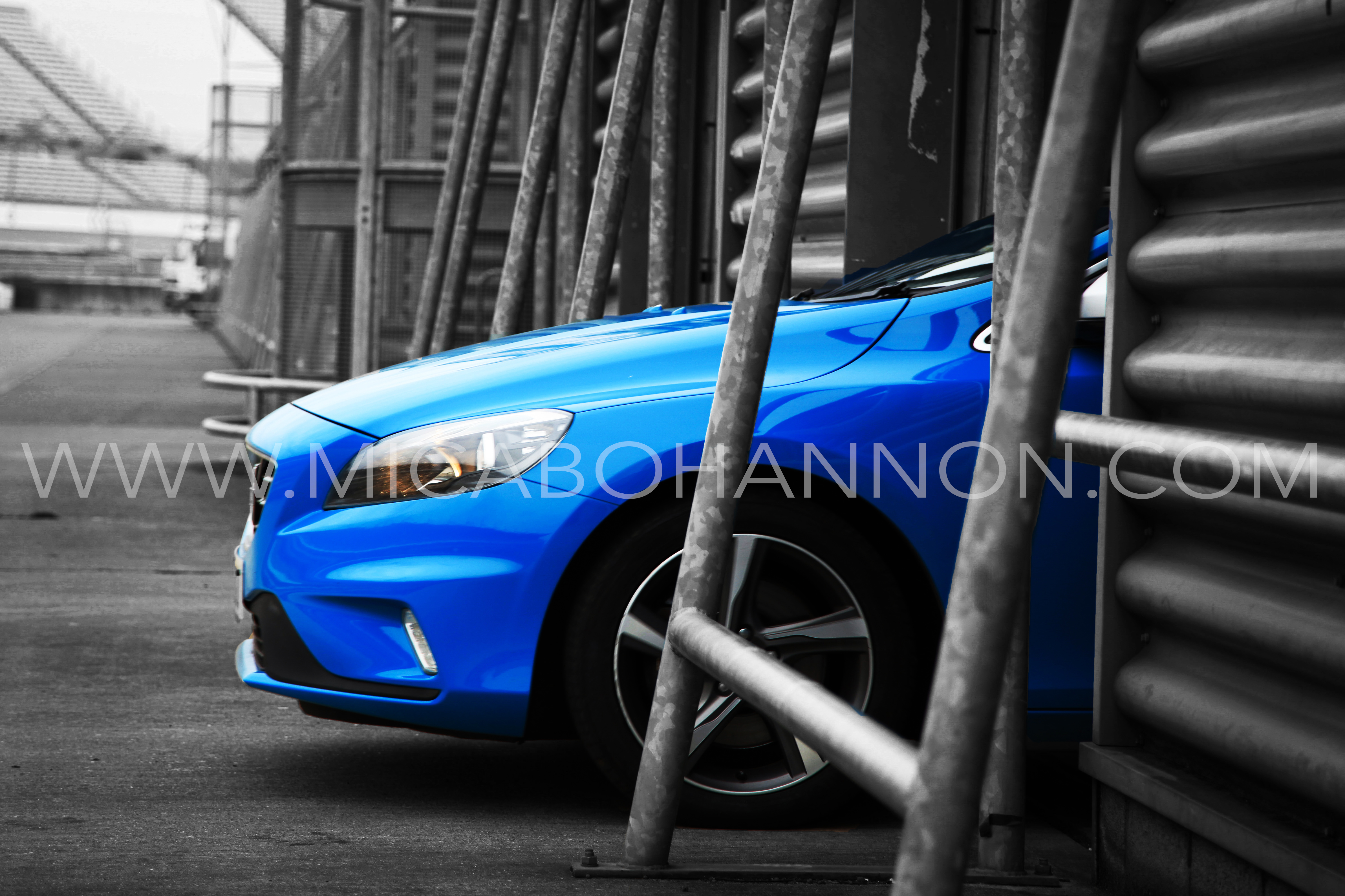 front of a blue volvo