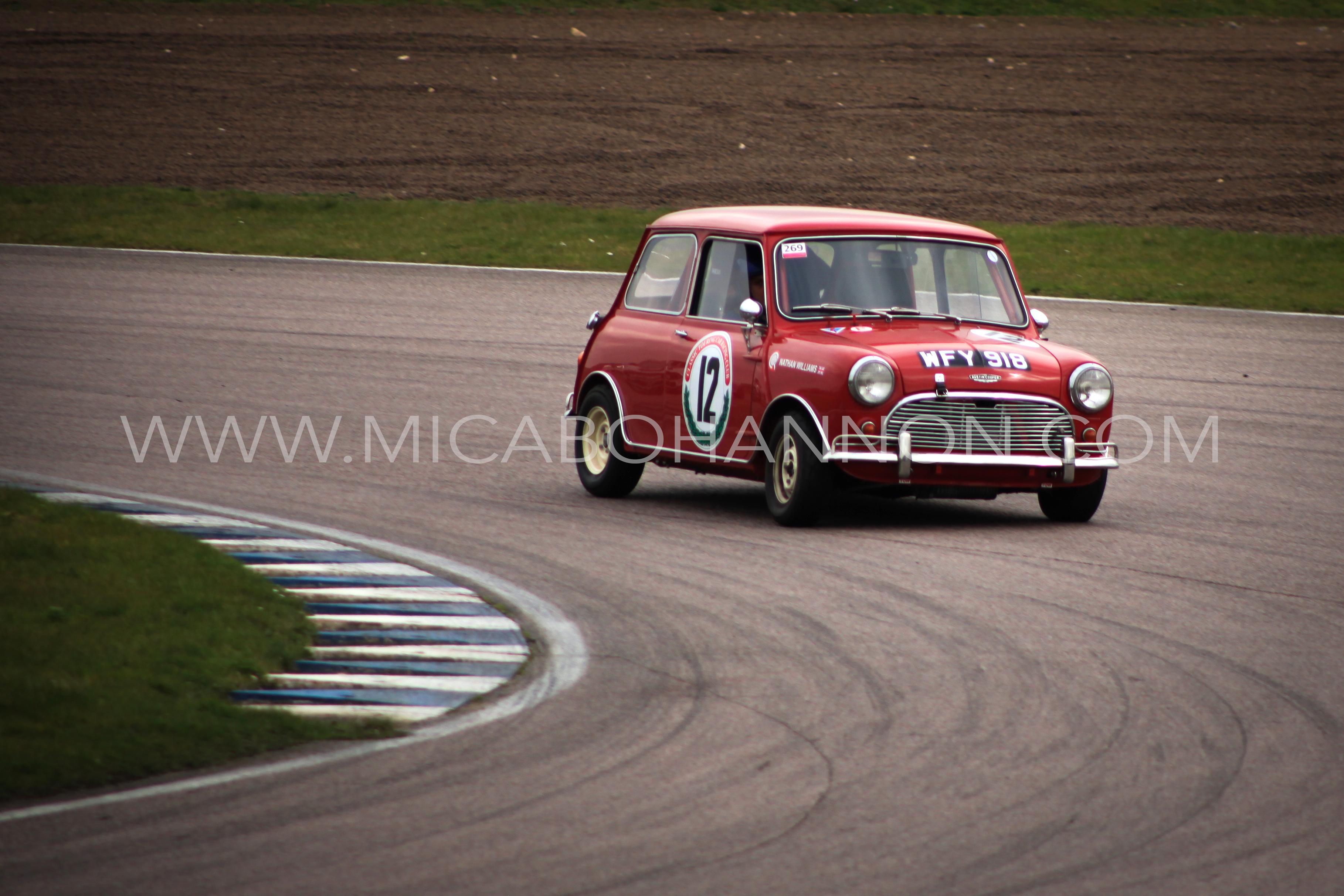 red mini going round corner