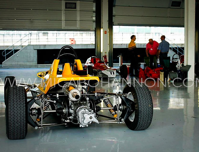 back of a yellow formula ford in pit garage