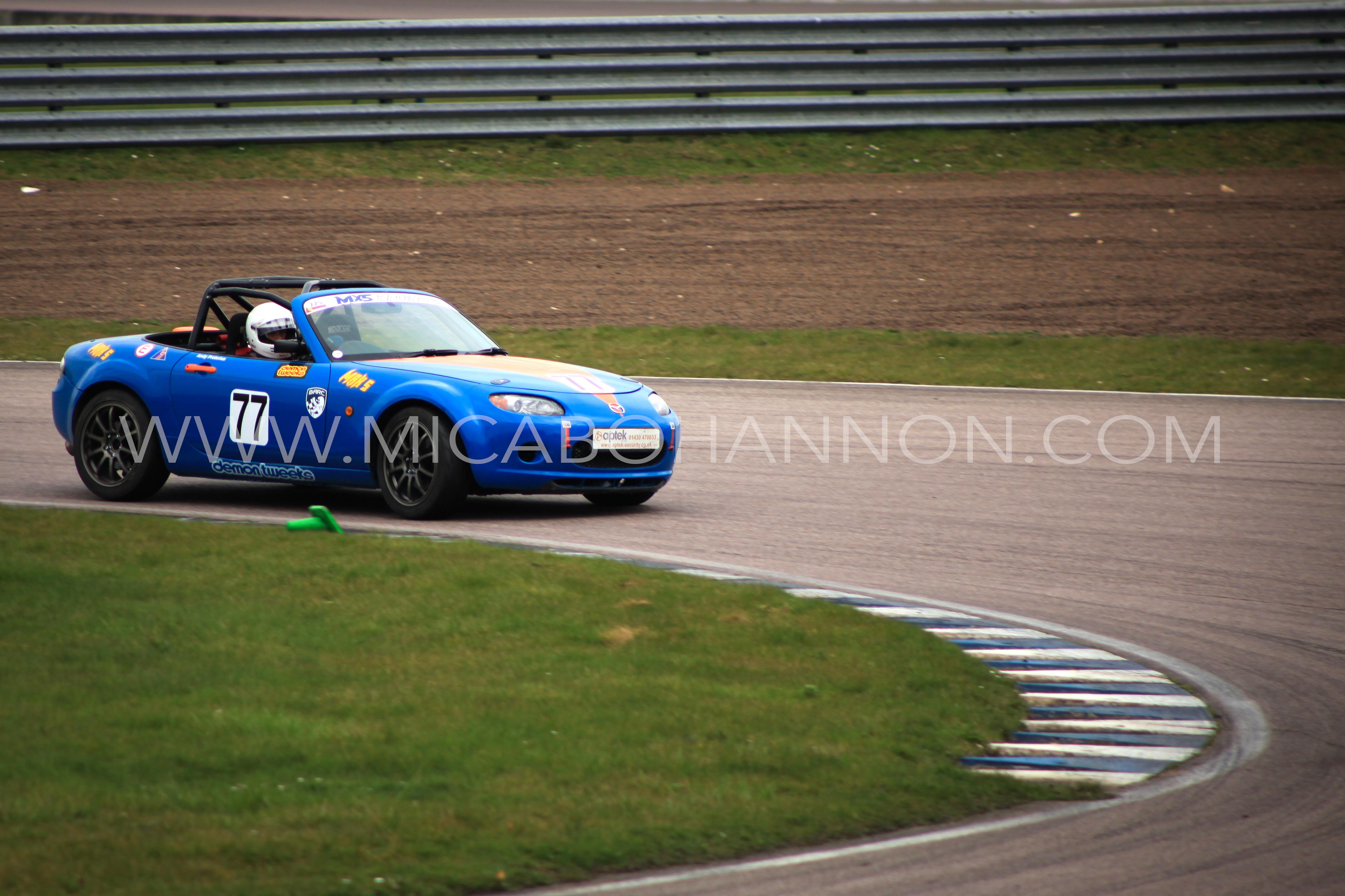 blue car going round corner