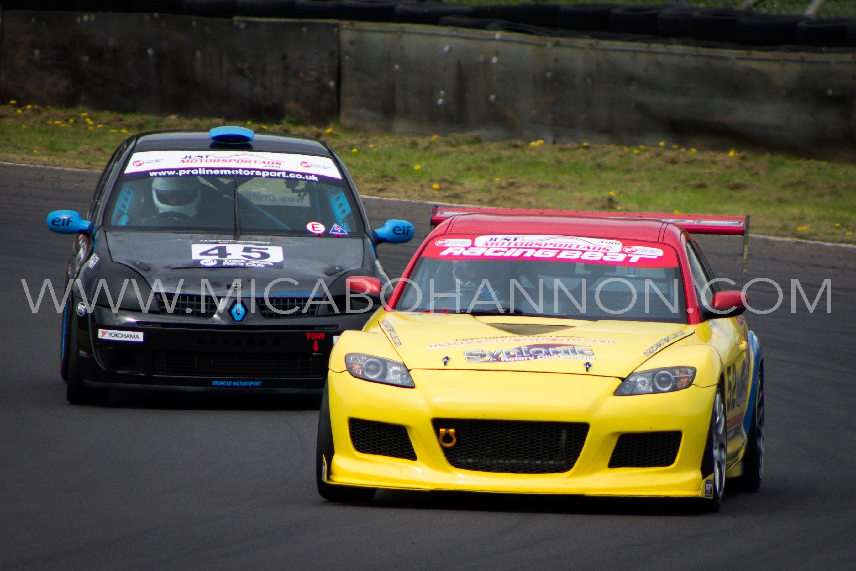 2 cars competing for corner