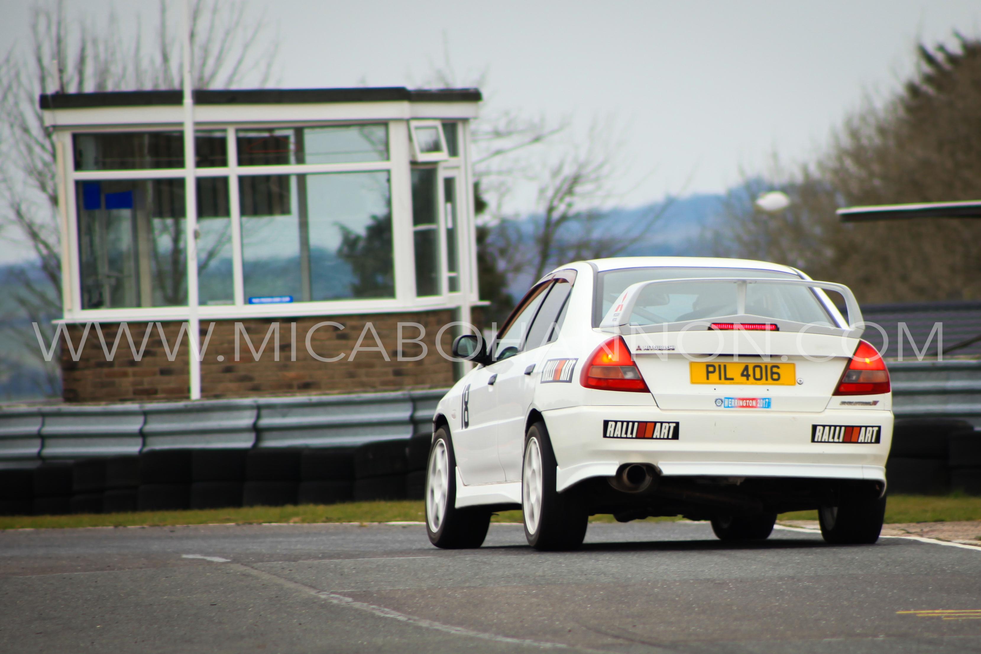 white car about to take corner