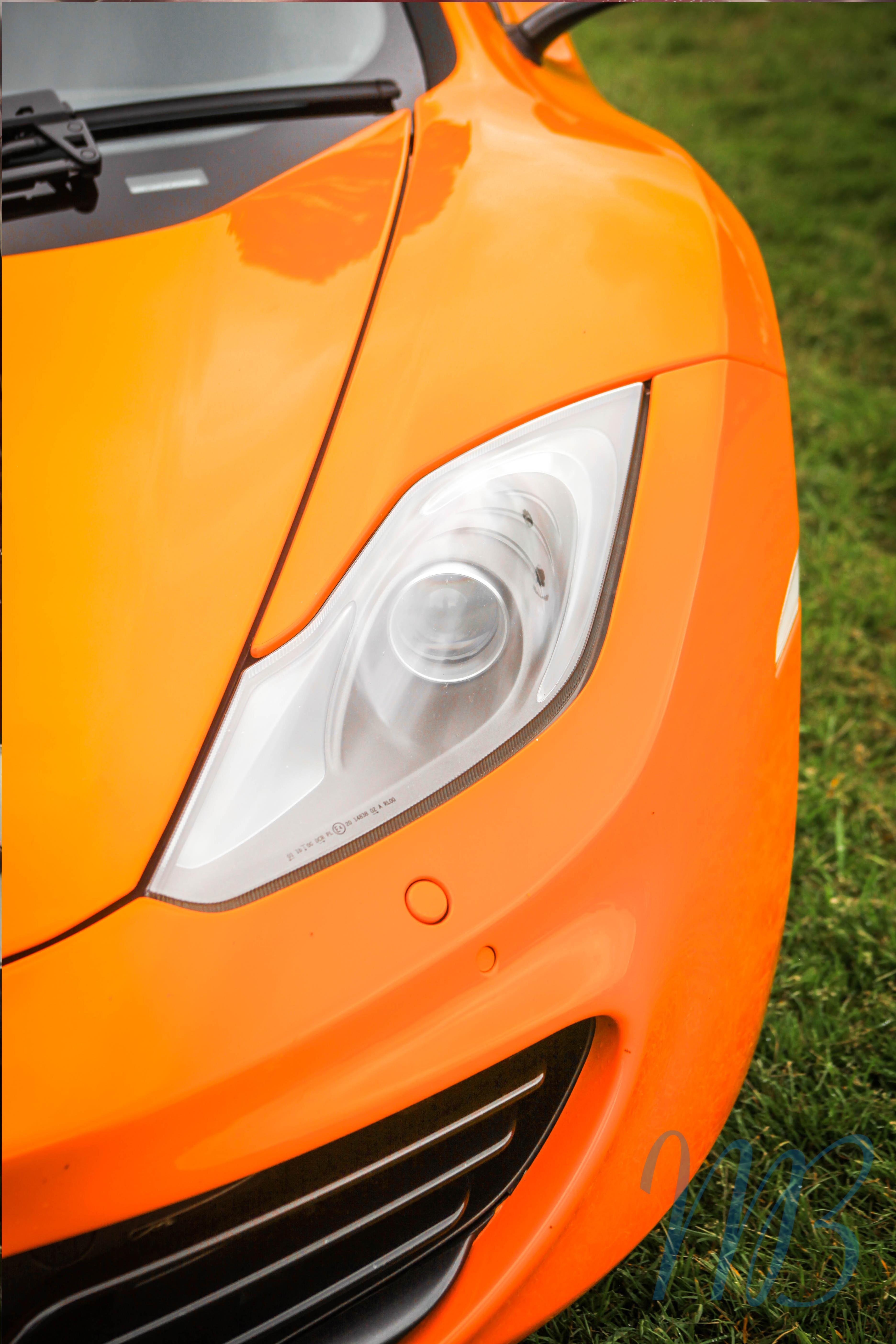 lights from an orange mclaren