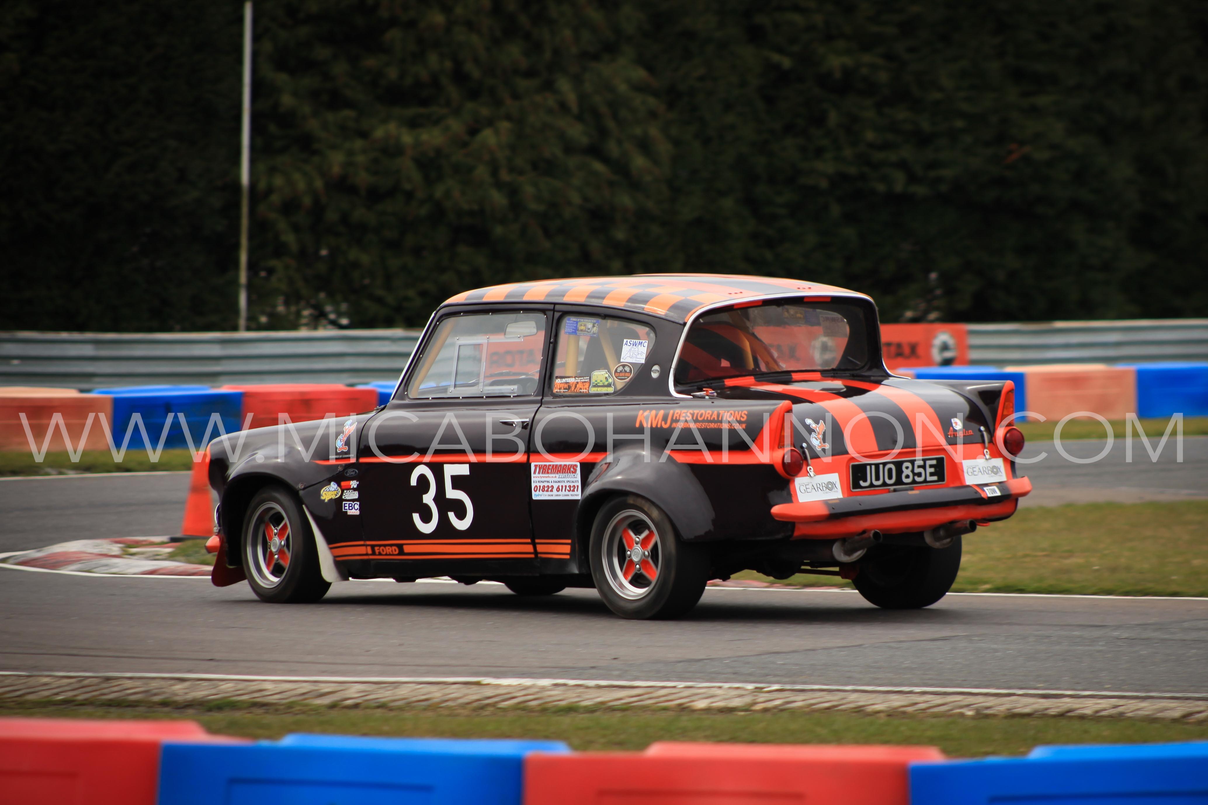 sprint with black and orange car