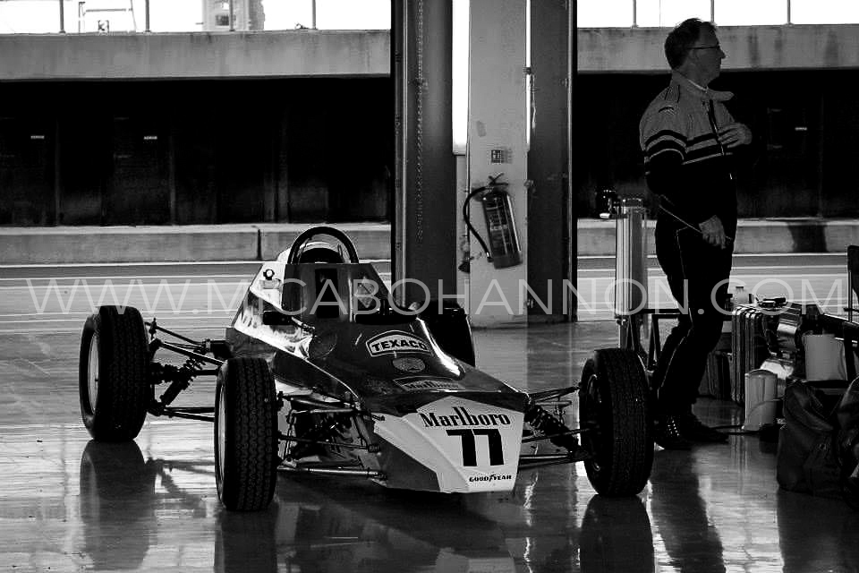 black and white car in pit garages