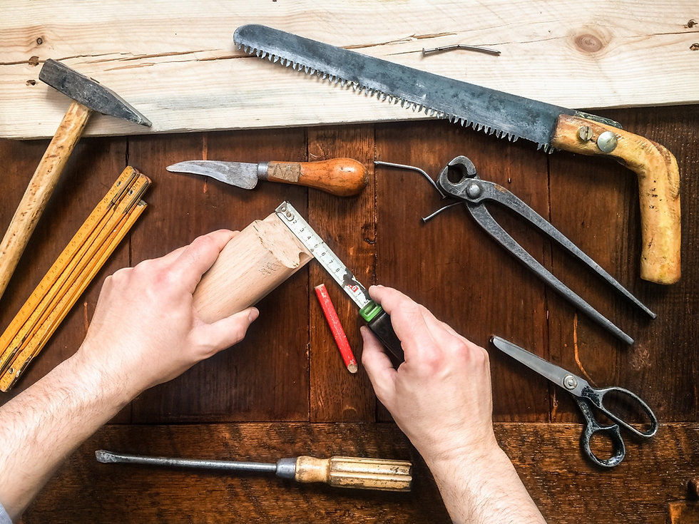 man-repairing-wooden-things-using-tools_