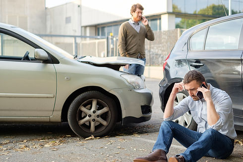 Two Men Calling Car Help Assistance After An Accident.jpg
