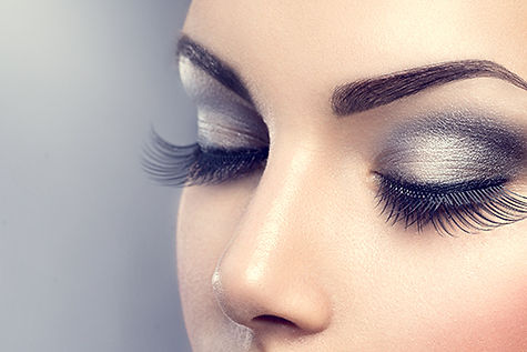female with smokey eye makeup long eyelashes eyelash extensions