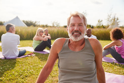 portrait-of-mature-man-on-outdoor-yoga-retreat-wit-RB3YHRM.jpg