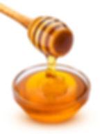 Honey dipper and bowl of pouring honey i
