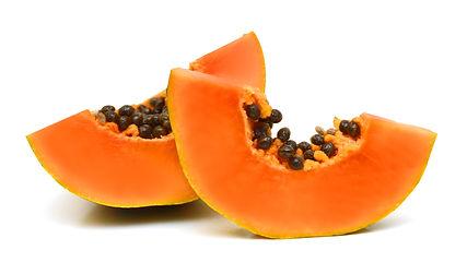slices of sweet papaya on white backgrou