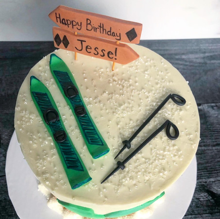 Ski themed chocolate birthday cake