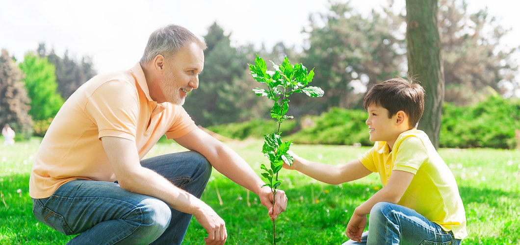 earth day father and son planting tree.jpg