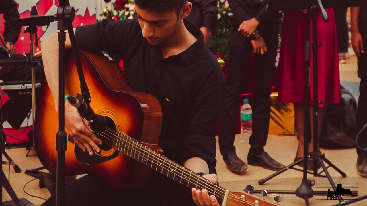 Aaryan on fingerstyle guitar