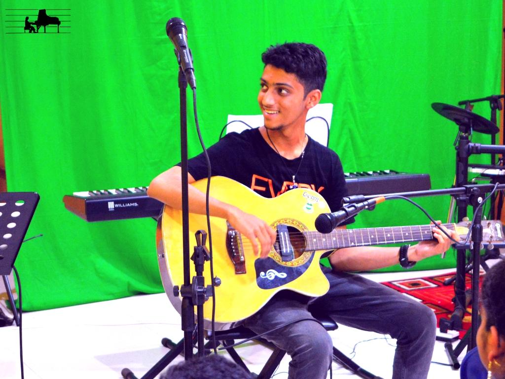 Aaryan at the guitar