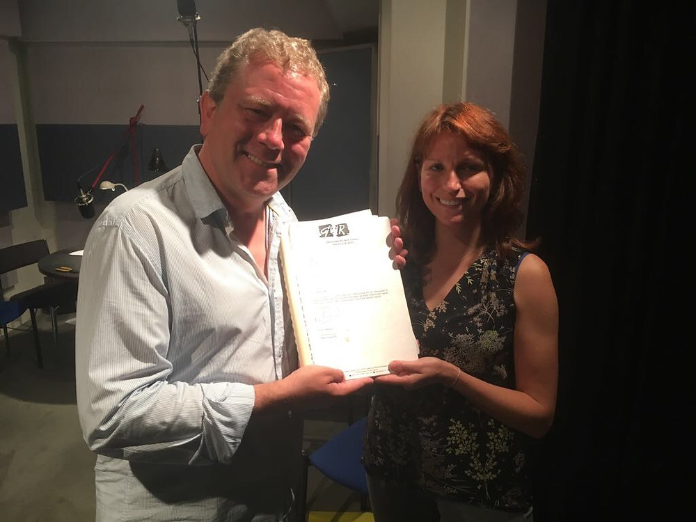 Impressionist Jon Culshaw and writer Cara Jennings with the original document which established Classic FM 25 years ago in the recording studio.