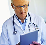 Male Doctor holding an Ipad