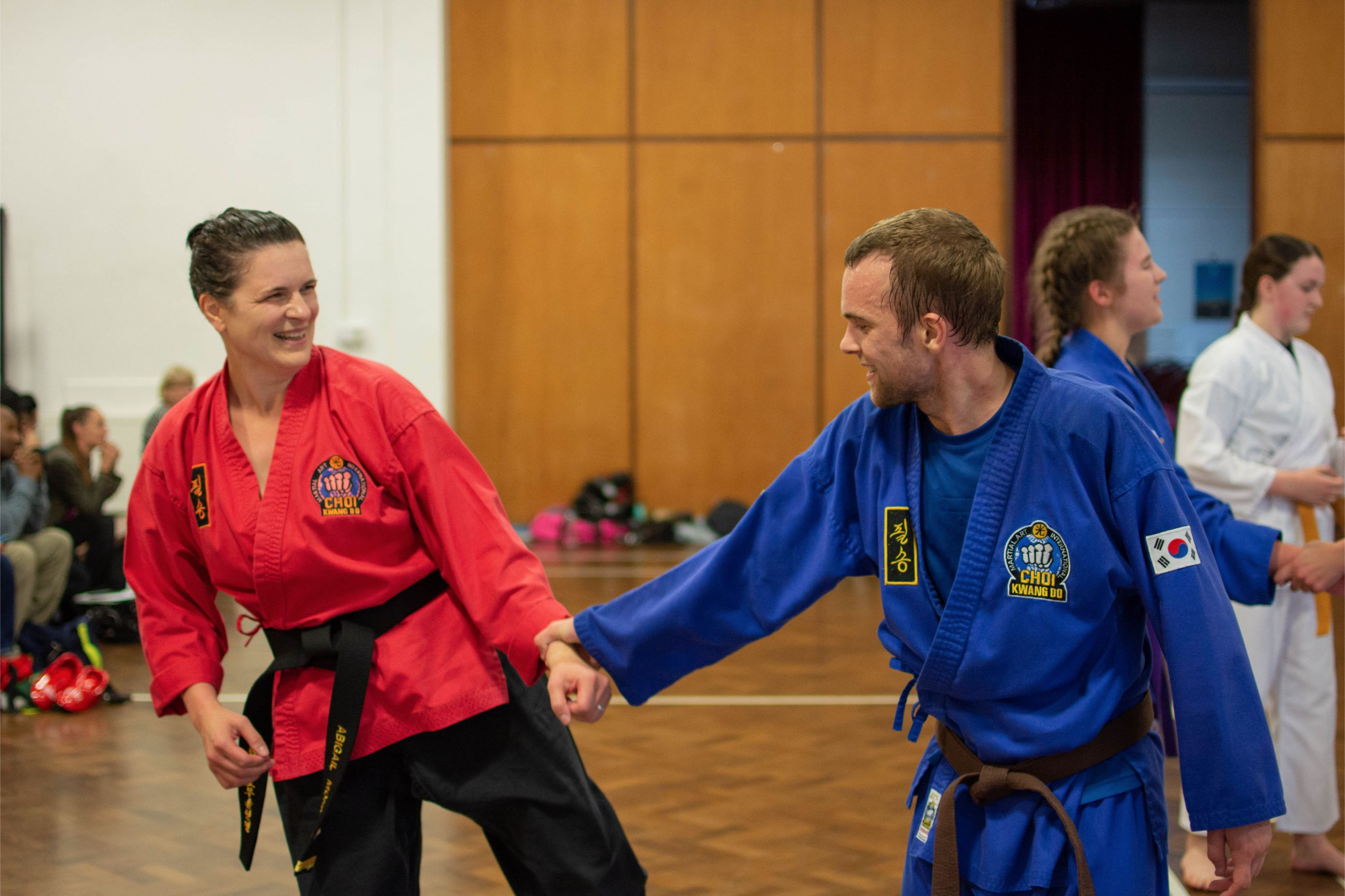 Lady and man doing martial arts