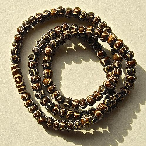 Natural Carved Brown-Colored Bone Beads w/ Batik Print Accent Mala