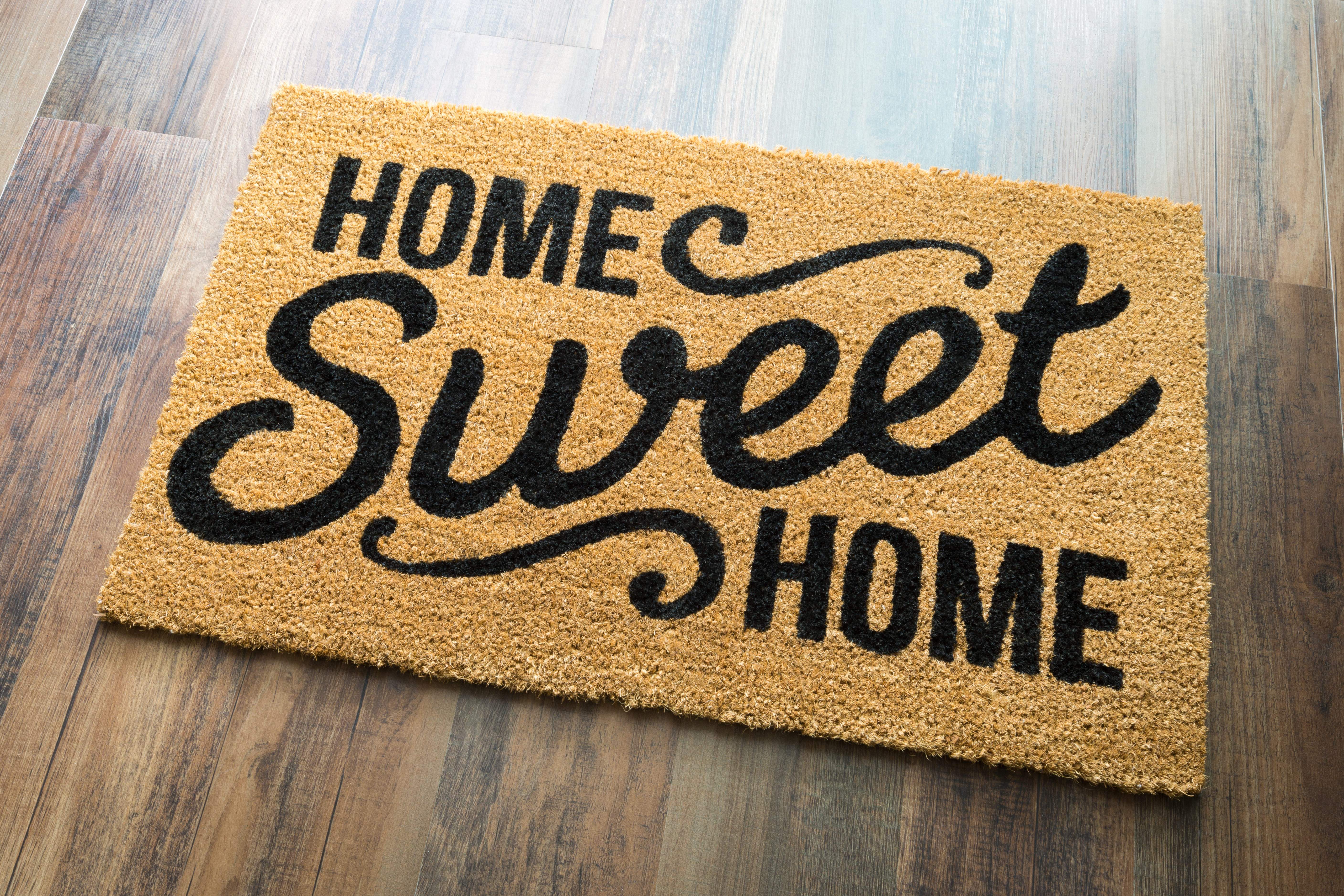 Home Sweet Home Welcome Mat On Wood Floo