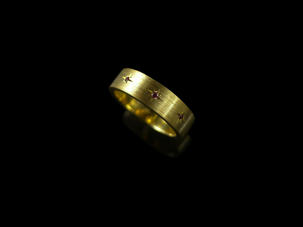 Brushed gold and ruby APS ring