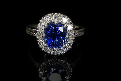 blue sapphire and diamond halo ring aps.