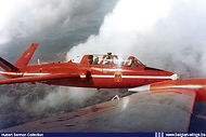 """Fouga Magister MT-5 of the """"Red Devils"""" aerobatic display team in formation with MT-33 in 1966. For the 1965 and 1966 """"Red Devils"""" display seasons MT-5 was used by Cpt. Delbecke as the Reds """"Solo""""."""