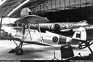 Silver doped Stampe Vertongen SV-4B V-34 in a hangar at Beauvechain airbase.