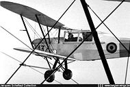 Stampe Vertongen SV-4B V-13 still in silver overall finish in flight in the early fifties.