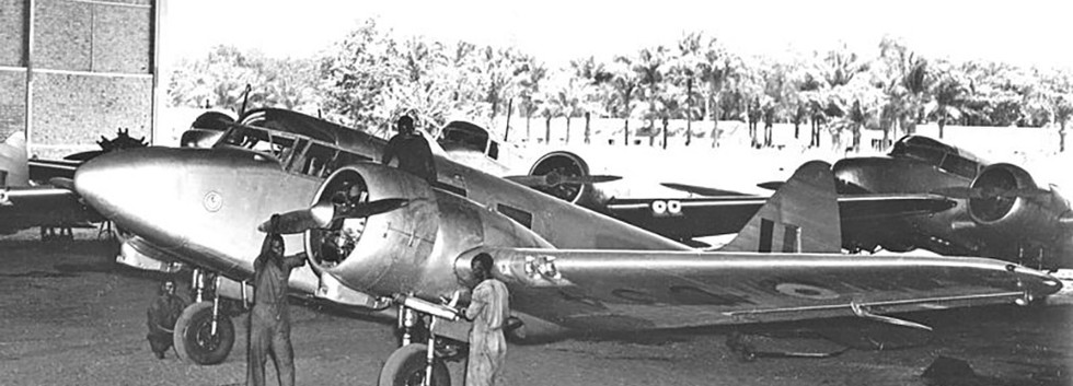 Avimil Airspeed AS.65 Consul C-34 being maintained at the Force Publique/Openbare Weermacht hangar at Ndolo/Leopoldville.