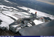 Alpha Jet AT20 over the snow covered Ardennes.