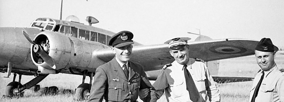 Belgian and french pilots pose in front of Avro Anson I NA-7 during the Vichy airshow on 15 August 1949.