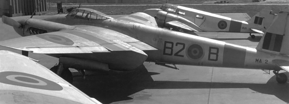 """De Havilland DH.89 Mosquito T/TT.3 MA-2/B2-B target towing aircraft at Koksijde in the early fifties.   Airspeed Oxford O-21, the Koksijde  """"base hack"""" is parked behind the Mosquito."""