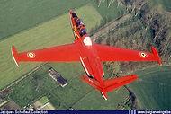 "Potez-Air Fouga CM-170 Magister MT-31 in ""Red Devils"" aerobatic team colour scheme on low level flight."