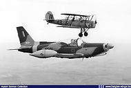Siai Marchetti SF260M ST-01 in formation with its predecessor Stampe Vertongen SV.4B V-43 in 1970.