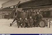 Ground crew members posing with Auster A.O.P. 6 A-20