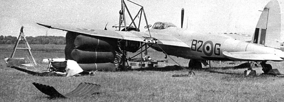 """After having lost its left undercarriage leg in a landing accident at Koksijde airbase on 4 June 1954 De Havilland Mosquito TT.6 MC-1/B2-G   is being lifted by means of an """"airbag""""."""