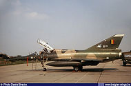 """Dassault Mirage VBD BD-11 (sporting a special """"Cocotte"""" crest on the tail (designed by Hubert Sermon), being maintained at Bierset airbase on April 20th, 1982."""
