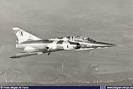 Dassault Mirage 5BD BD-05 of N° 8 Squadron in flight. Notice the extended speedbrakes.