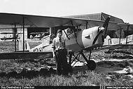 A student-pilot posing in front of Stampe Vertongen SV-4B V-42 at Goetsenhoven airbase.