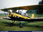 """Pilot Leo Lambermont ready to execute one of his superb displays in Stampe Vertongen SV-4B V-64 sporting the """"Les Manchots"""" color scheme."""