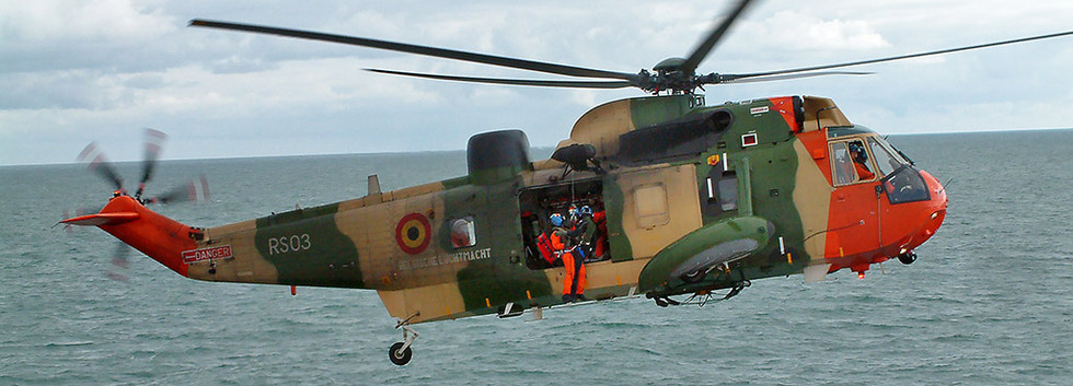 """Westland Seaking Mk.48 RS-03 performing a simulated rescue off the British coast during the filming of the movie """"Windkracht 10"""" on March 22nd 2006."""