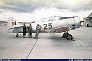 Local maintenance personnel pose in front of North American Harvard 4K H-23 at Kamina airbase in the late fifties.