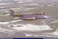 "Gloster Meteor T.7 ED-37 in flight over the ""Het Zwin"" estuary near Knokke."