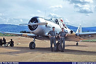 Two pilots of the Flight Appui Feu pose in front of North American AT-6D/Harvard 4KA H-35 at Kigali in the spring of 1960.