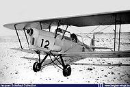 Stampe Vertongen SV-4B V-12 being prepared for a flight at snow covered Goetsenhoven.