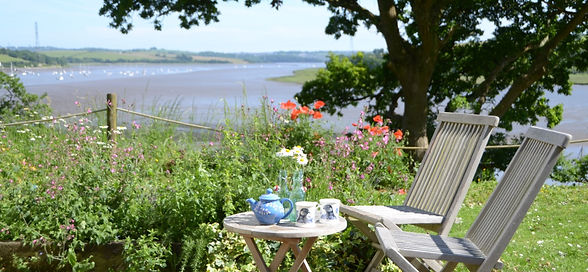 Afternoon tea on the terrace in the sun by the Count House in Devon