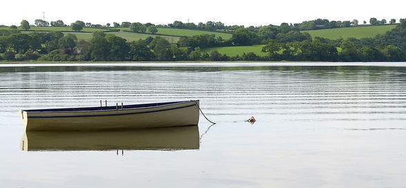 Rowing boat moored on the River Tamar in Devon