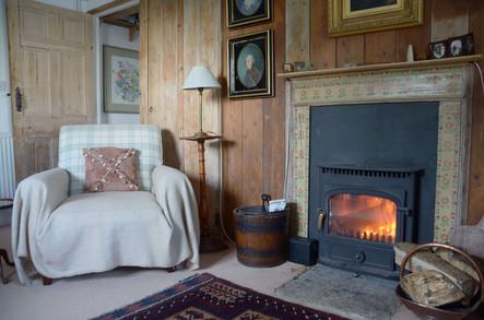 Armchair beside the wood burner